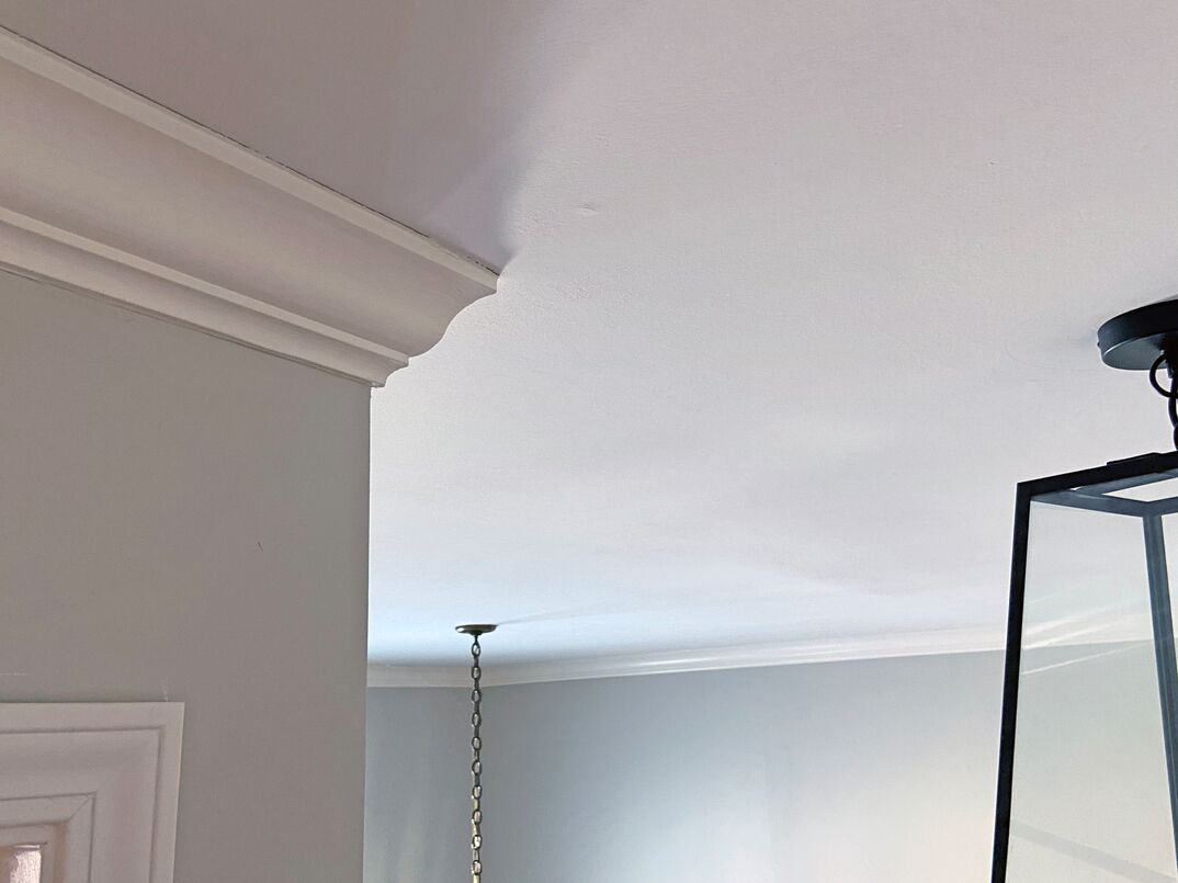 ceiling in a residential home with crown molding