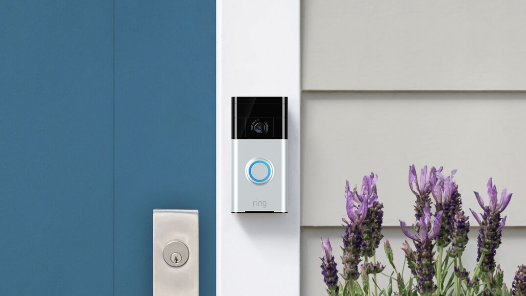 Close up shot of a 1st generation Ring video doorbell on a residential home
