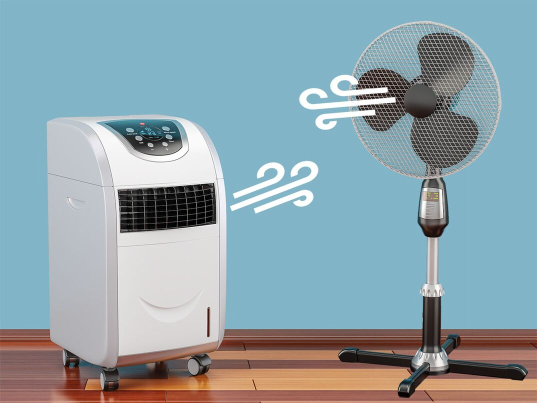 Photo shows a portable AC unit facing a tower fan as they  battle  over which is more efficient.