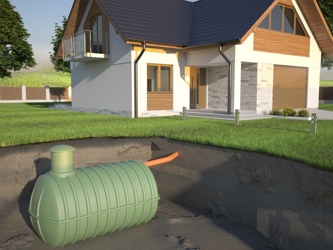 a cross-section graphic illustration of a septic tank buried in a front yard