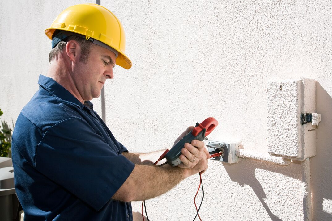 electrician checking outdoor meter
