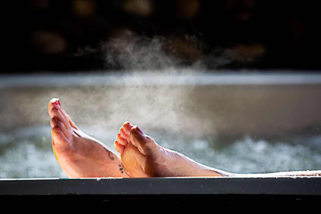 Woman with her feet up while in a hot tub
