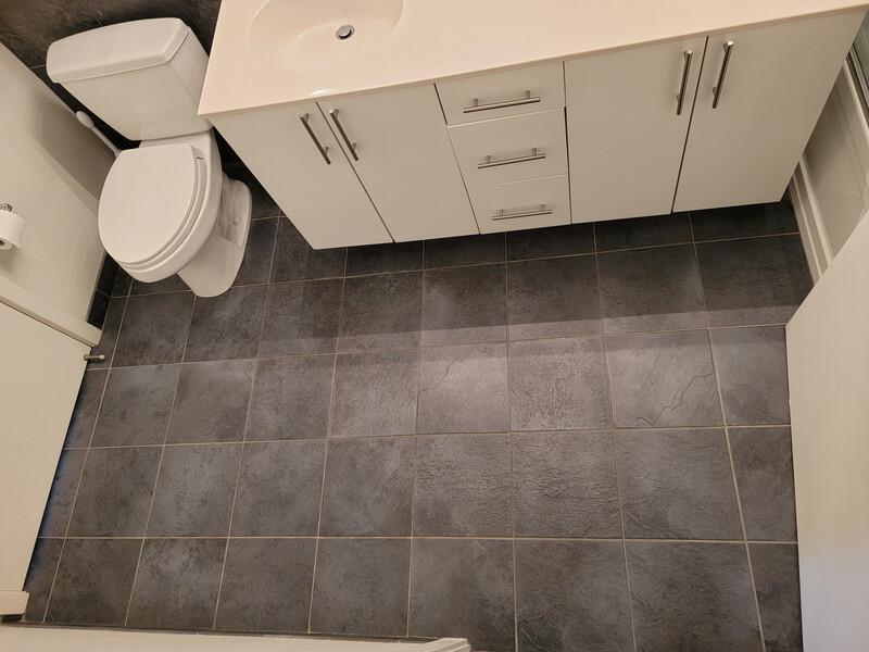 grey tile floor in bathroom