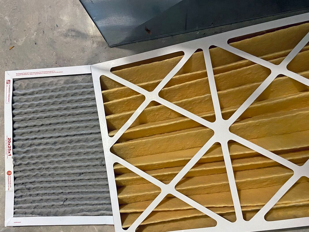Clean furnace filter and dirty filter in a side by side comparison