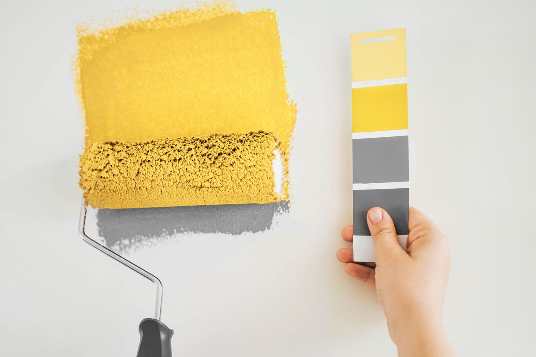 Close up paint brush and color charts. Concept of color of the year.