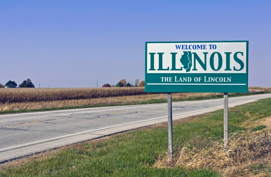 Welcome to Illinois sign on the side of a road