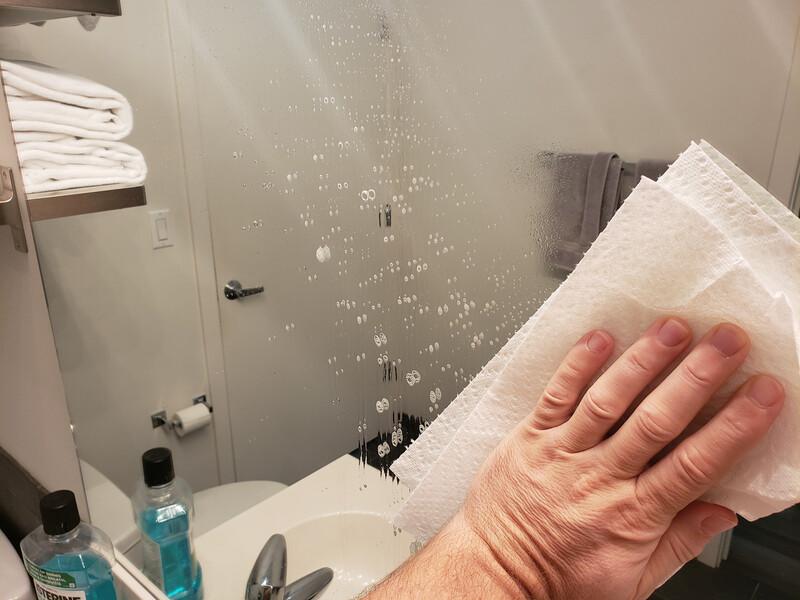 cleaning bathroom mirror