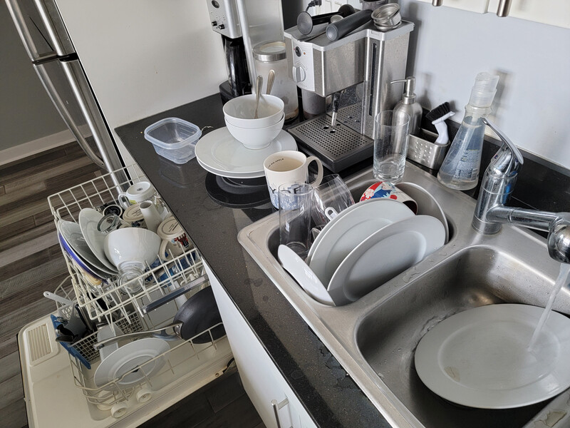 Rinsing dishes in a double sink