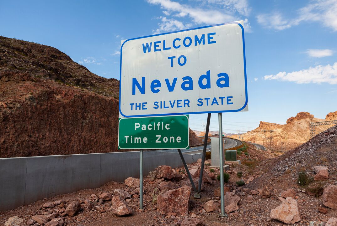 Welcome to Nevada and the Pacific Time Zone Road Sign