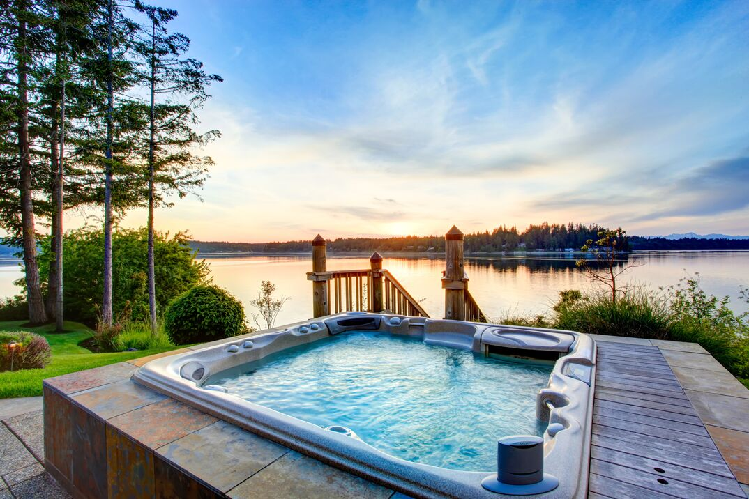 Awesome water view with hot tub in summer evening