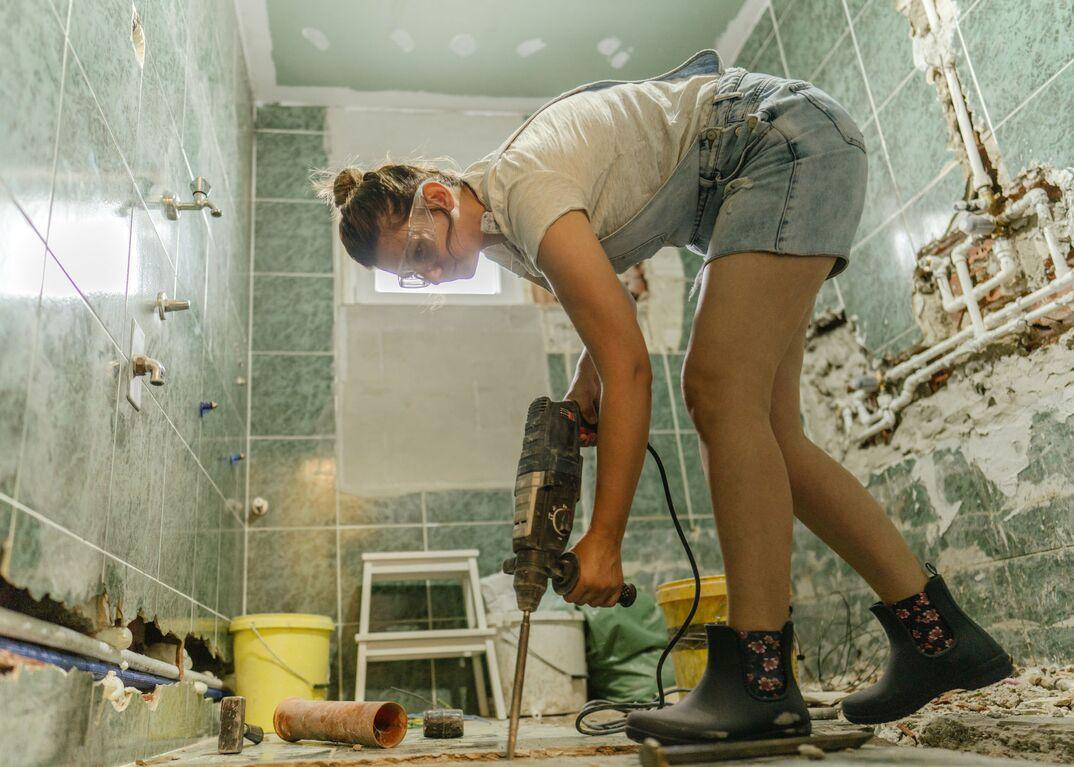 Woman renovating bathroom