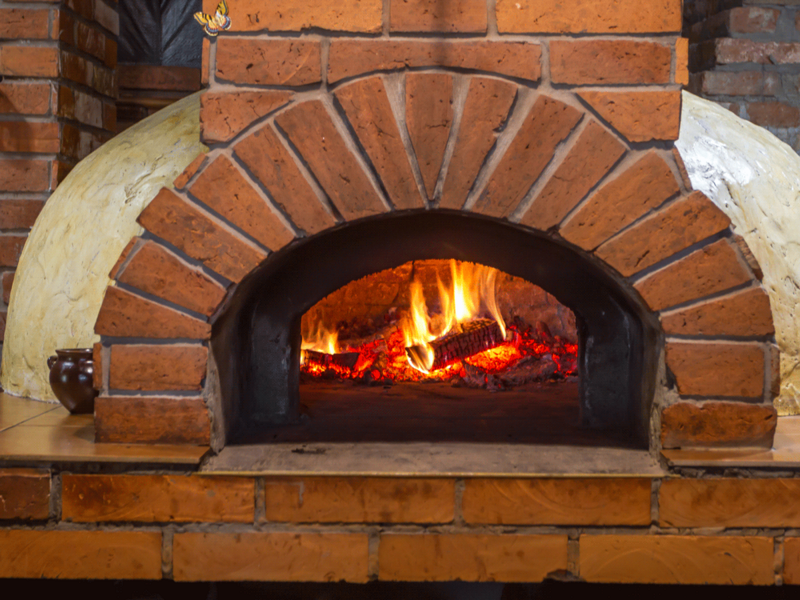 animation of a wood-fired brick pizza over with a flickering fire