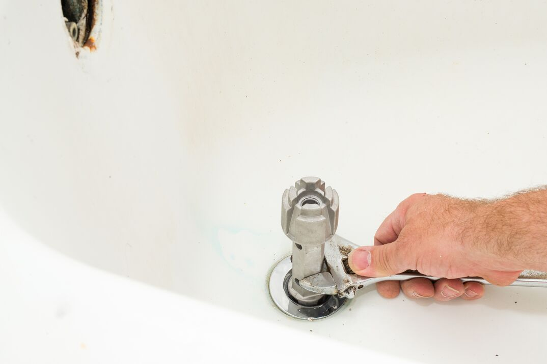 Replace Bathtub Drain Flange with Wrench and Specialty Tool