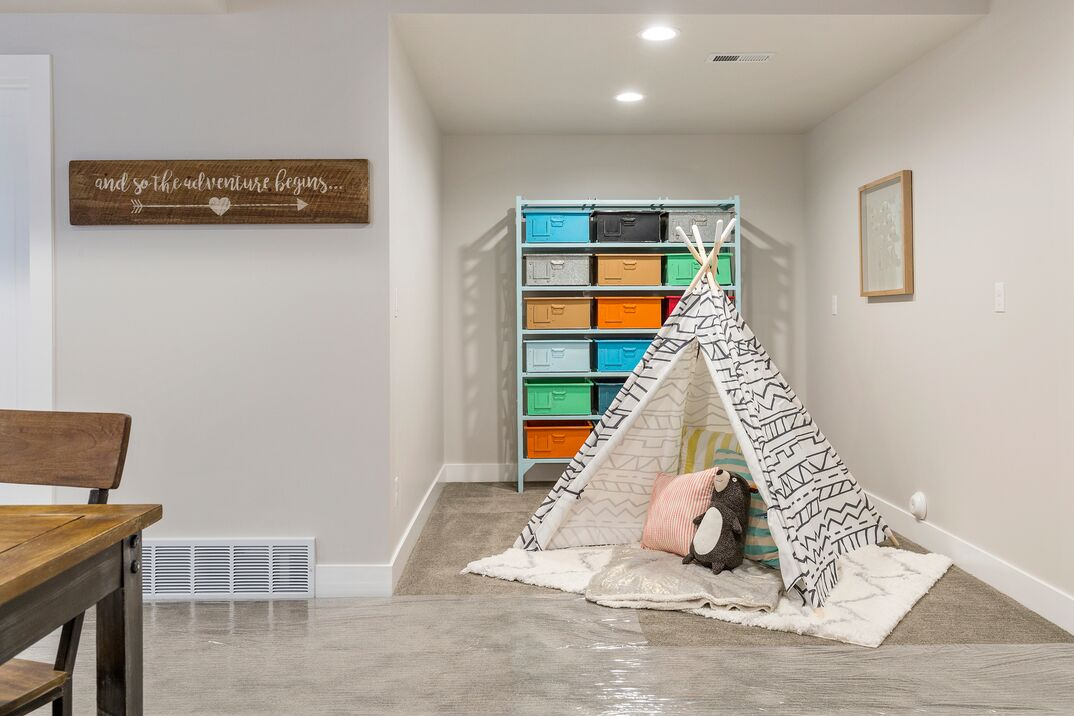 Wonderful playland for kids in basement of custom home