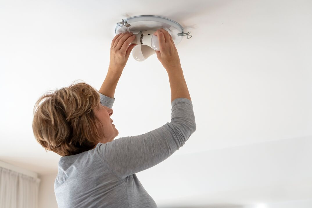 Woman Bulb replacement at home