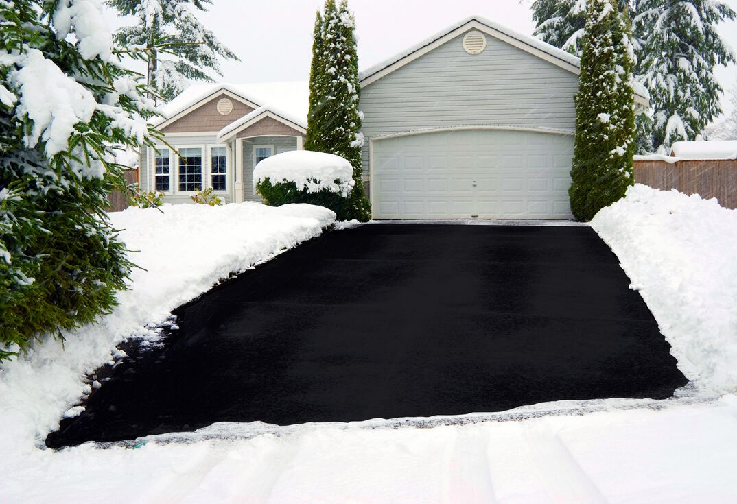 Simulated graphic of a heated driveway during a winter snowfall