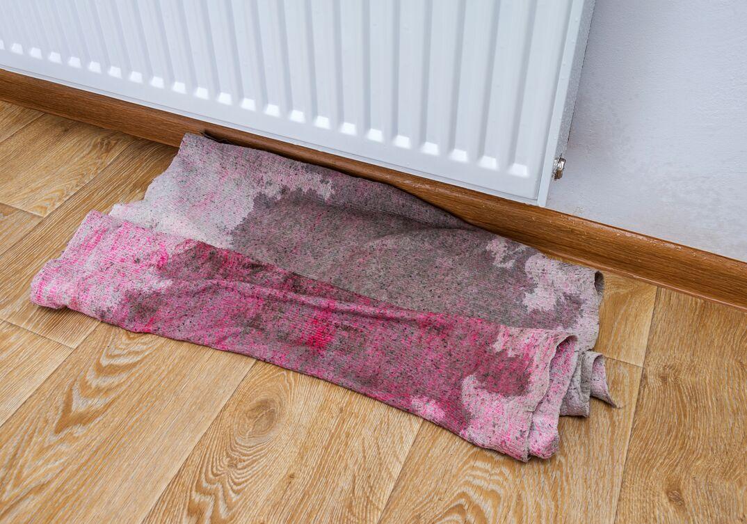 Leaking radiator heater flooded the hardwood floor of a residence