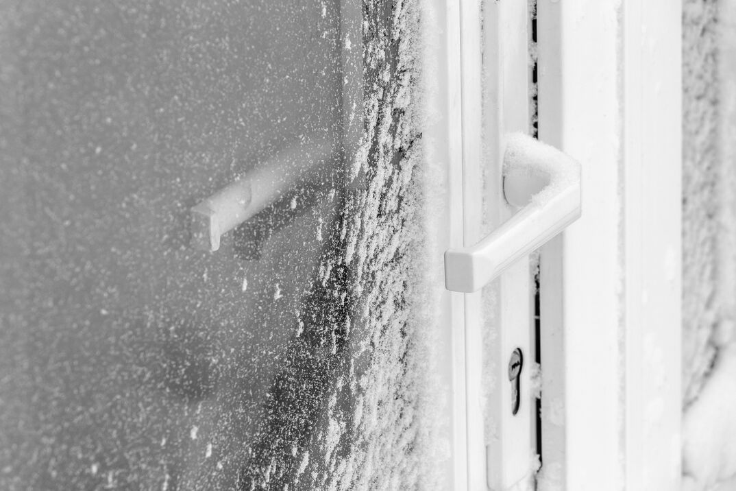 The storm door is covered with snow