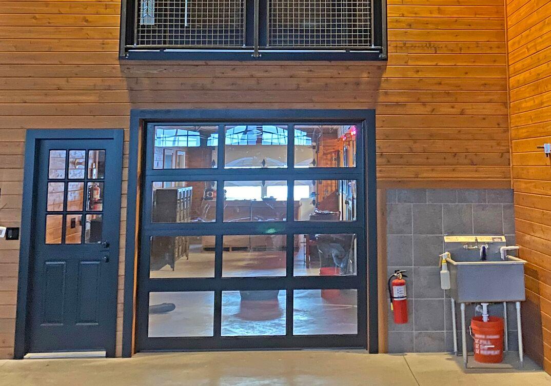 Glass garage door inside of a barn