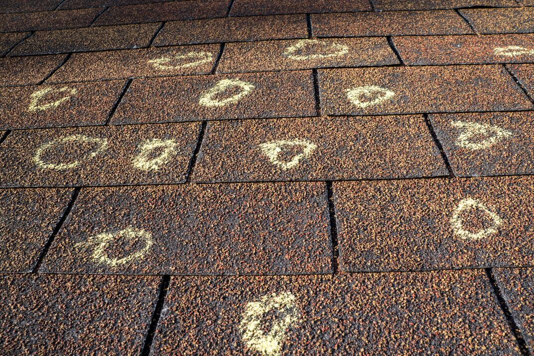 Insurance Adjuster Marked Roof With Hail Damage