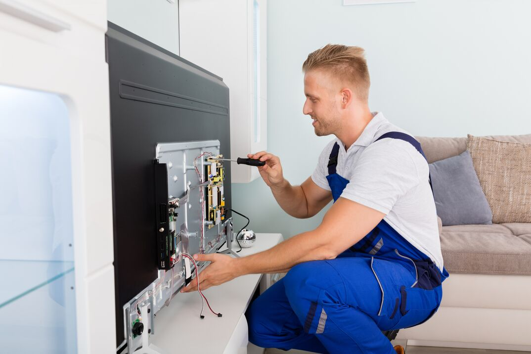 Electrician Repairing Television