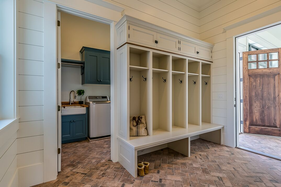 Immaculate laundry room and mudroom combo