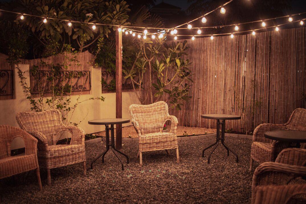 Cozy Backyard Patio Setup with string lights