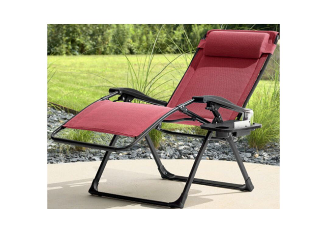 Recalled anti-gravity chair with eyelets attaching red fabric to metal frame