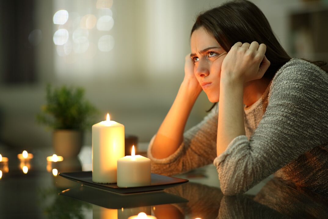 Woman sitting in dark during power outage