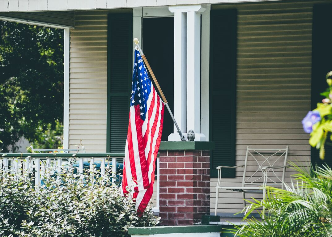 American flag mounted on house