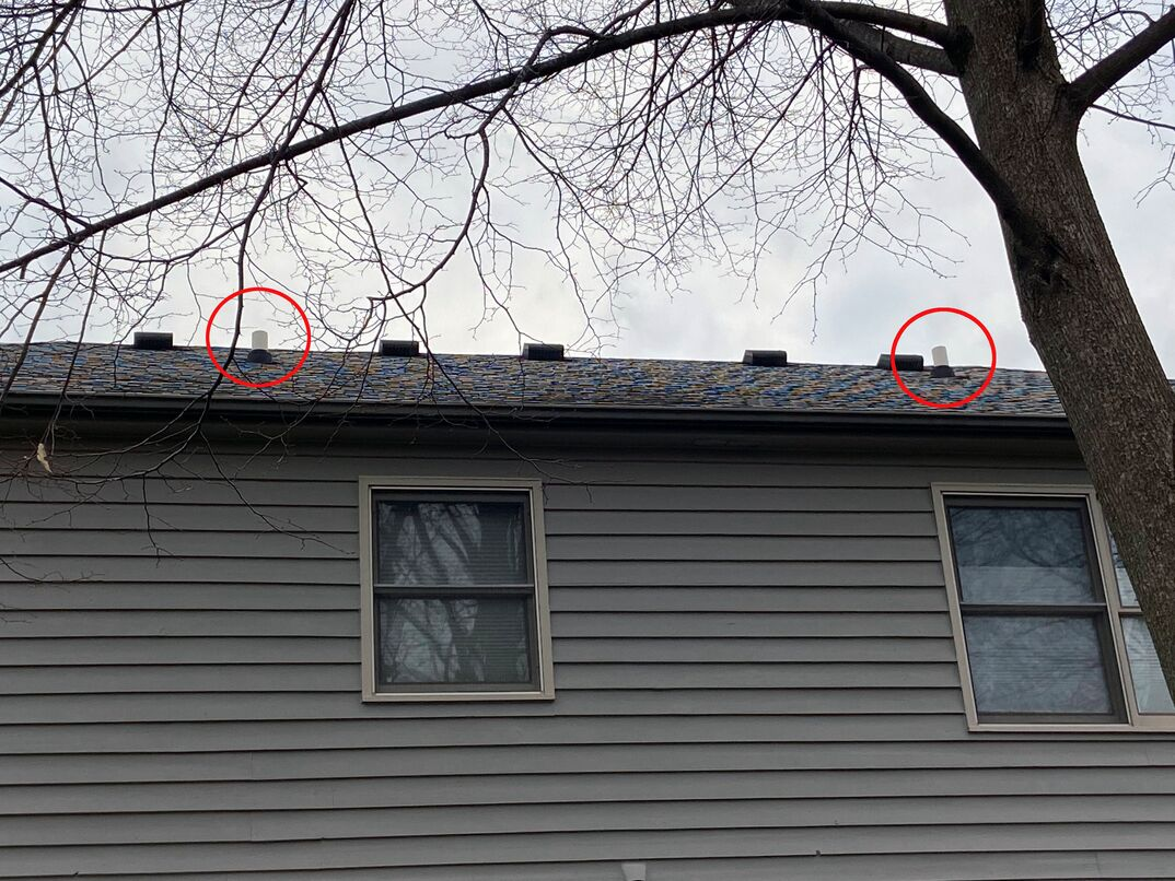 two highlighted exterior plumbing ehxaust vents