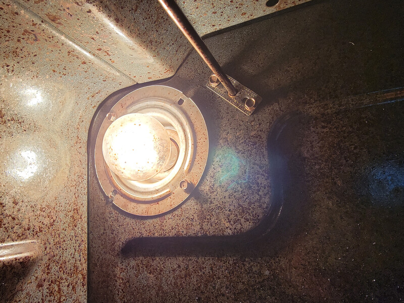 interior of an oven with lightbulb