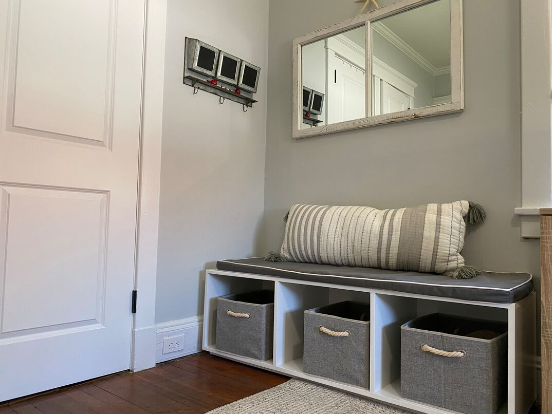 Mud  space  inside the home with storage bench