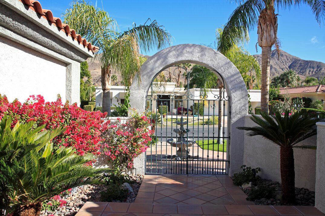 Inside Luxurious Xeriscaped Courtyard Looking To Street