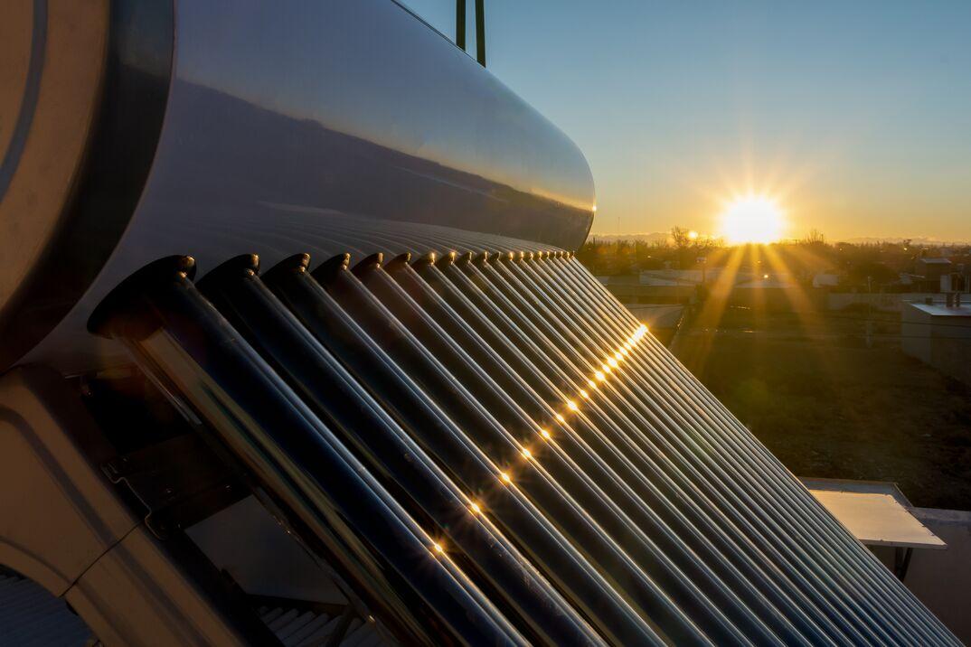 solar hot water tank at sunset
