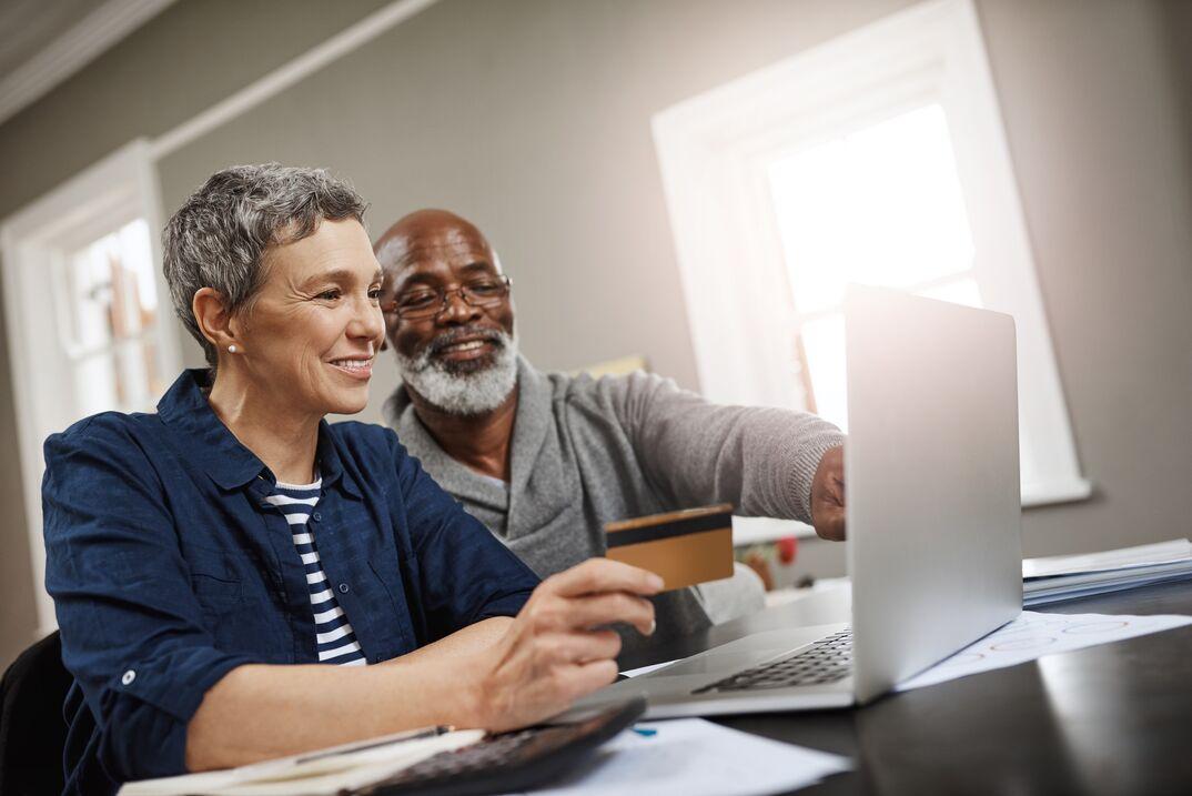 happy couple pays bills online