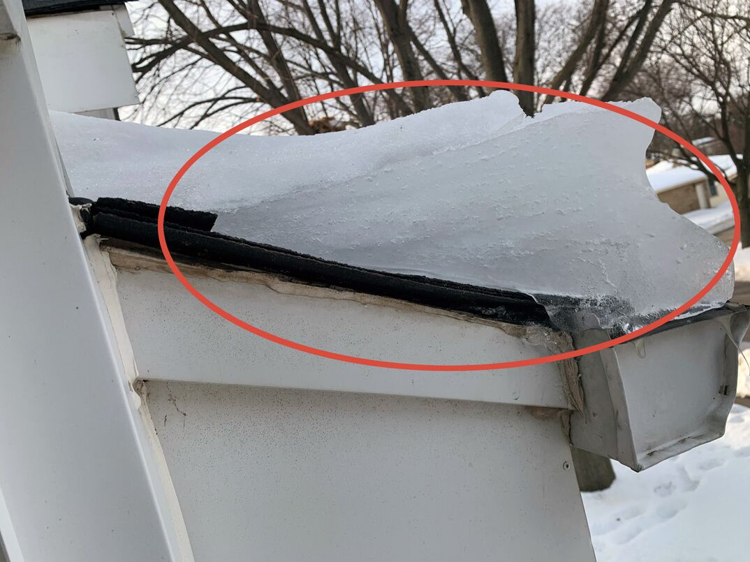 a picture perfect example of an ice dam on a residential roof