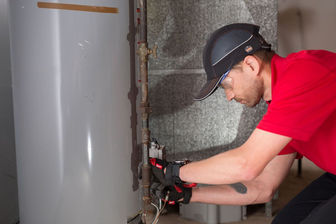 technician with water heater