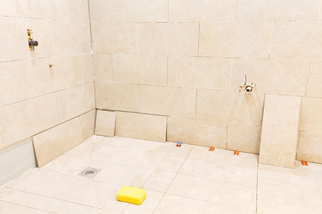 Tiling work in a bathroom wet room