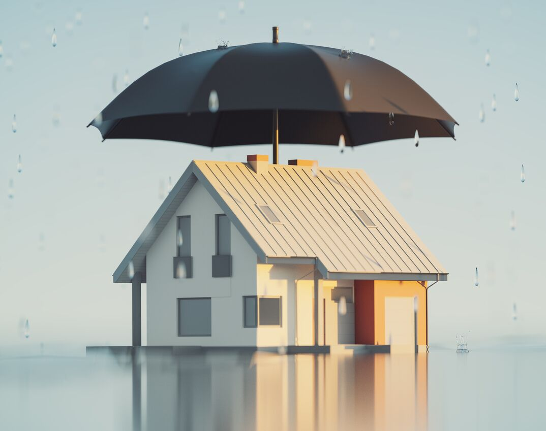 a 3D render of a House covered by a large umbrella to represent insurance