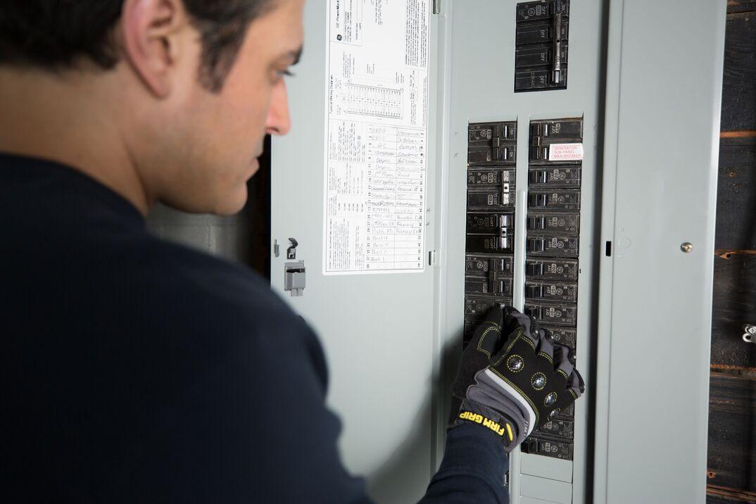 technician checking fuse box