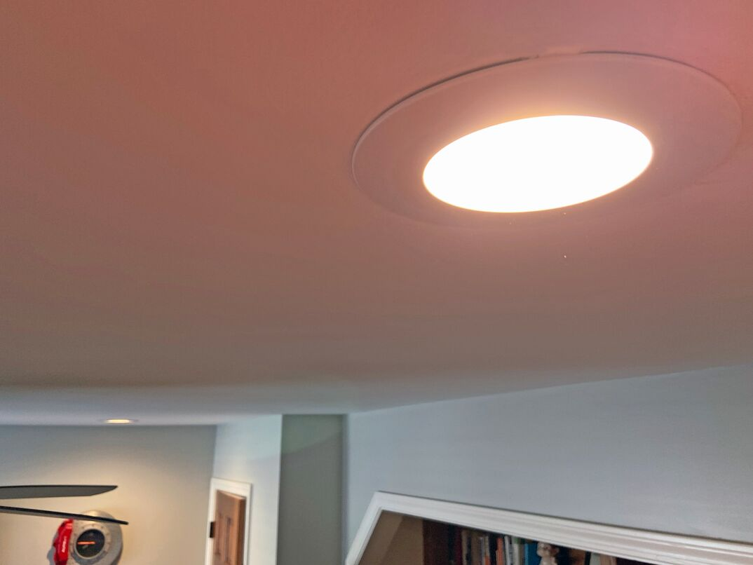 close up shot of a recessed LED light mounted into a bedroom ceiling