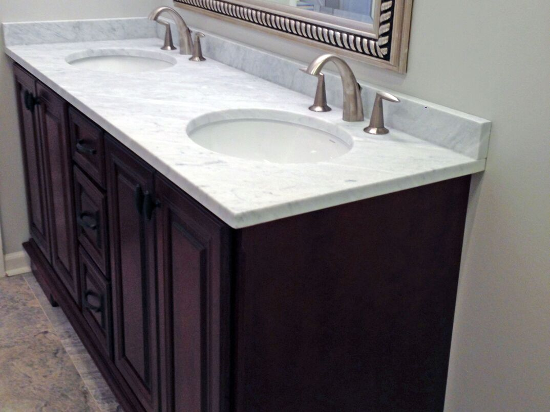 photos show before and after transformation of a bathroom double sink vanity