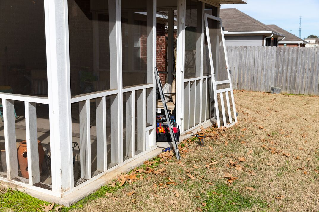 photo of a screened in porch being built