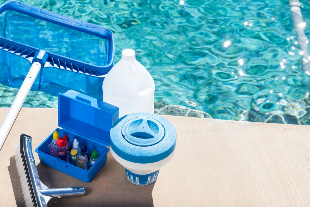 swimming pool supplies and chemicals set up near the water for testing