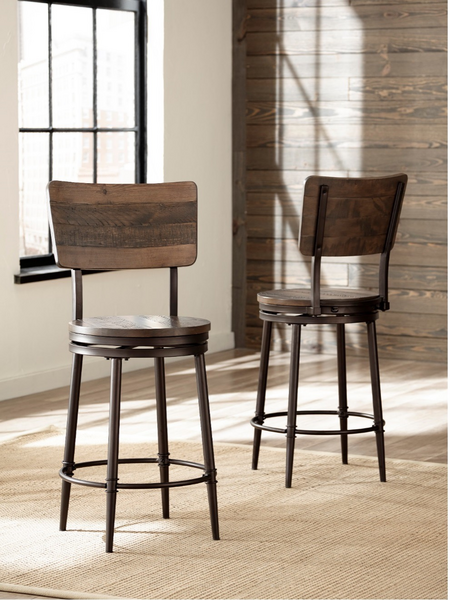 Two wooden and metal stools in a bright room