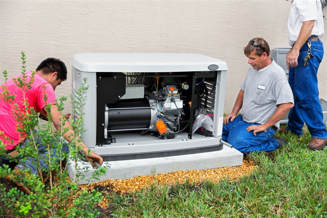 technician checking external HVAC unit