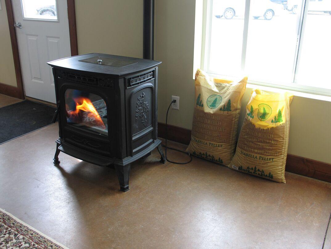 Wood pellet burning stove