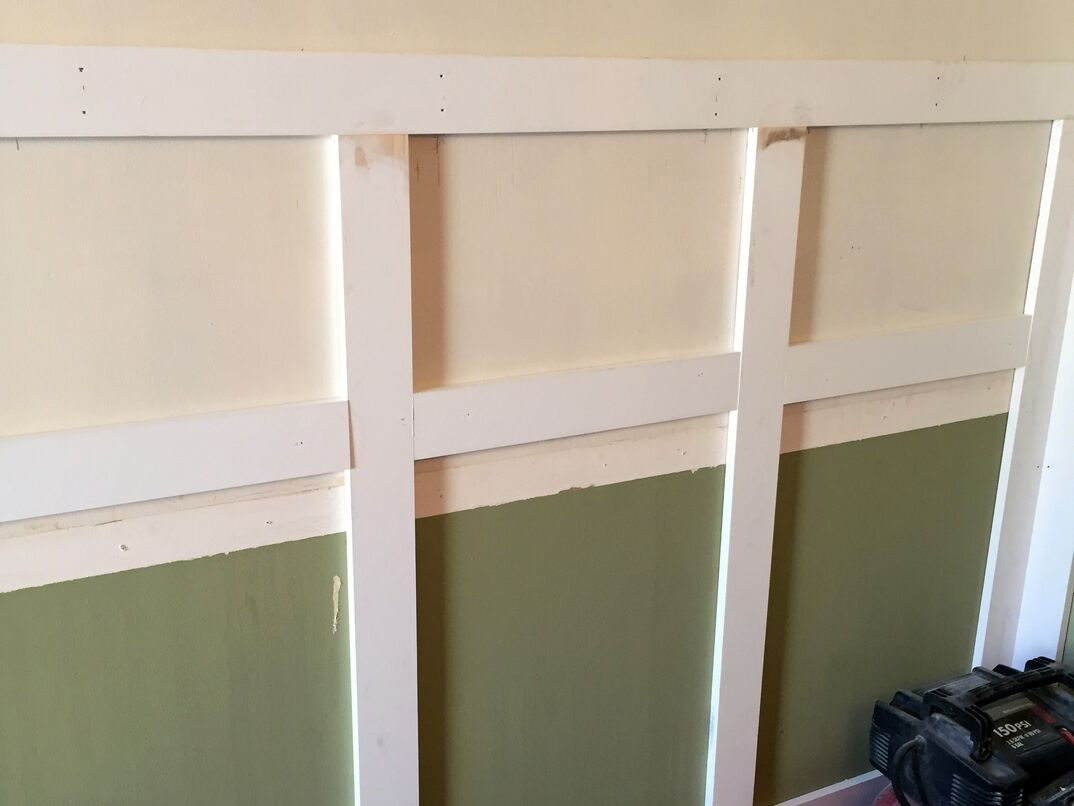 Wainscoting being attached to a wall