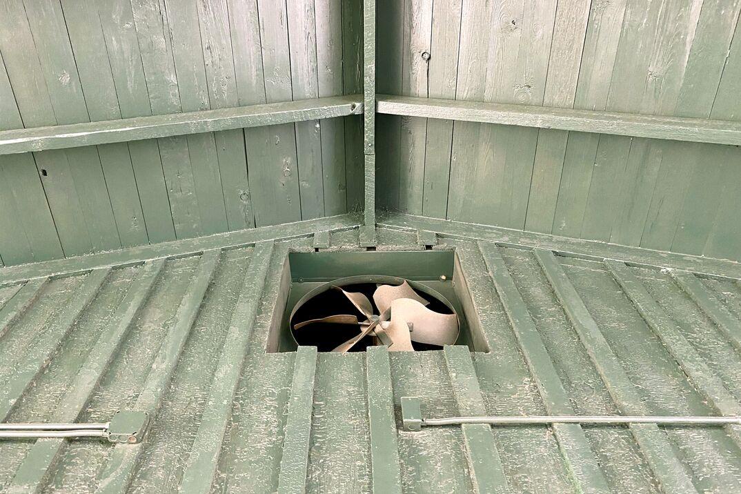 green barn roof rafters ventilation fan